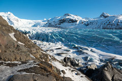 Svinafellsjokull glacier tongue in winter, blue ice covered by snow and mountain peaks, Iceland Royalty Free Stock Photography
