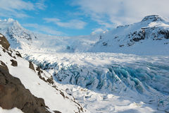 Svinafellsjokull glacier tongue in winter, blue ice cracks covered by snow, Iceland Stock Images