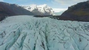 Svinafellsjokull Glacier. Ash and Cracks. Iceland. Aerial View