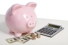 Svinbank och pengar Arkivbilder