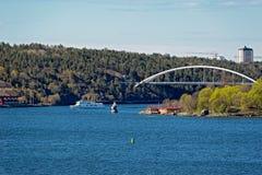 Svindersviksbron Svindersviken Bridge, Nacka, Sweden. Rocky shore of Stokholm skerries with small ship and bridge across Svindersviken Svindersviksbron. Nacka Stock Image
