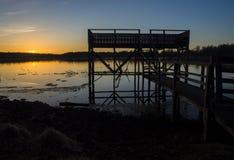 Svinstasjön de coucher du soleil Images stock