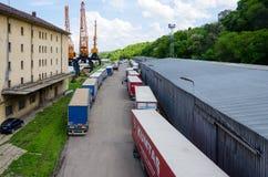 International port of Svishtov on Danube river, Bulgaria. Svishtov, Bulgaria - April 28, 2016: Long queue of stationary trucks with trails at the international Stock Photos