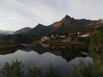 Svolvaer. City the main center of Lofoten peninsula with mountains in the background and reflected in the sea Stock Photos