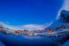 SVOLVAER, LOFOTEN ISLANDS, NORWAY APRIL 09, 2018: Outdoor view of some boats in the harbor with buildings behind in. Svolvaer, in March International cod Stock Photos
