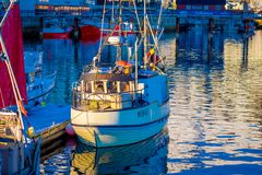 SVOLVAER, LOFOTEN ISLANDS, NORWAY - APRIL 10, 2018: View of Fishing boat in harbour, Svolvaer, Lofoten Islands County is stock photos