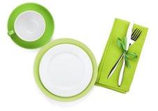 Svuoti i piatti, la tazza di caffè e l'argenteria verdi Immagine Stock