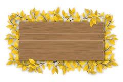 Svuoti il segno di legno con il ramo di albero giallo di autunno Fotografia Stock
