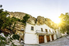 Svyato-Uspensky cave monastery at sunset, Chufut-Kale, Crimea Stock Image