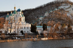 Svyatogorsk Lavra  is illuminated by the sun at sunset Stock Image