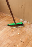 Swab cleaning dust and litter after renovation Royalty Free Stock Photography