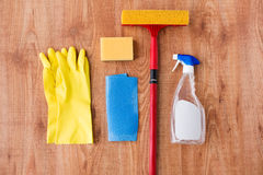 Swab with cleaning stuff on wooden background Royalty Free Stock Photo