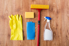 Swab with cleaning stuff on wooden background Stock Photos