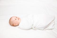 Swaddled infant Stock Photos