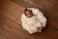 Swaddled Newborn Baby Girl stock photos