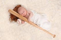 Swaddled Sleeping Baby Boy With a Baseball Bat. And Ball Royalty Free Stock Image
