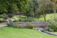 Swadlincote Park Derbyshire  water and stone feature. Water chanel, rock feature with stone and pebble inlays Stock Image