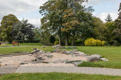 Swadlincote Park Derbyshire  water and stone feature. Water chanel, rock feature with stone and pebble inlays Royalty Free Stock Photos