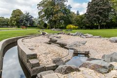 Swadlincote Park Derbyshire  water and stone feature. Water chanel, rock feature with stone and pebble inlays Royalty Free Stock Image