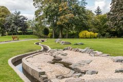 Swadlincote Park Derbyshire  water and stone feature. Water chanel, rock feature with stone and pebble inlays Royalty Free Stock Photo