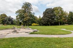 Swadlincote Park Derbyshire  water and stone feature. Water chanel, rock feature with stone and pebble inlays Stock Photo