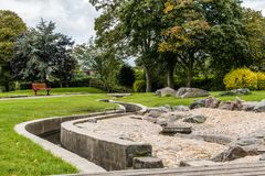 Swadlincote Park Derbyshire  water and stone feature. Water chanel, rock feature with stone and pebble inlays Stock Photos