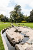Swadlincote Park Derbyshire  water and stone feature. Water chanel, rock feature with stone and pebble inlays Stock Photography