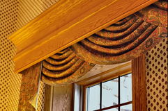 Swag Curtains. Window treatment with swage curtain and cornice stock photos