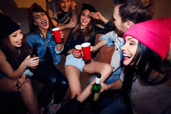 Swag gathering. Happy swag people with drinks spending time in night club Royalty Free Stock Photo