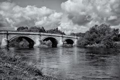 Swarkestone Bridge crossing the river trent, Black and White. Swakestone Bridge crossing The River Trent Derbyshire. Long exposure to show movement in the water Stock Images