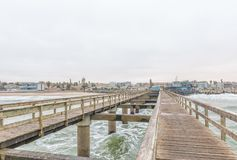 View of the historic jetty with Swakopmund in the back Royalty Free Stock Image