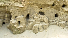 Swallow nests drilled in a sand at the banks of Danube river Stock Photography