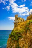Swallow`s Nest. Castle on a rock. Crimea. Swallow`s Nest. Attractions of Yalta. Alupka. Crimea. Castle on a rock. Under a rock the beautiful blue sea stock photography
