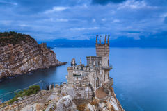 Swallow's Nest castle on the background of a stormy sky. Stock Photos
