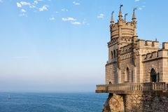 Swallow's Nest Castle in Crimea in blue evening. Travel to Crimea - view of Swallow's Nest Castle over Black Sea in Haspra District on Crimean Southern Coast in royalty free stock photography