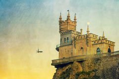 Swallow's Nest castle. The well-known Crimean castle Swallow's Nest with moon and bird, with vintage postcard style stock photos