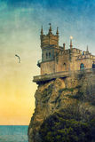 Swallow's Nest castle. The well-known Crimean castle Swallow's Nest with moon and bird, with vintage postcard style royalty free stock photo