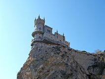 The Swallow`s nest lock on the steep rock. Crimea.  stock photography
