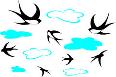 Swallows and clouds. Swallows  in the sky with some clouds Stock Image