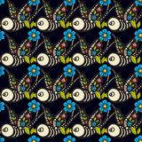 Swallows and flowers in an old-style tattoo. The day of the Dead. A seamless pattern on a black background. Stock Photo