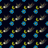 Swallows and flowers in an old-style tattoo. The day of the Dead. A seamless pattern on a black background. Texture for vintage scrapbooking, wrapping paper Stock Image