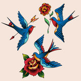 Swallows and flowers Royalty Free Stock Photo