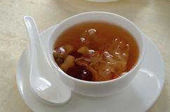Swallows nest Broth. Red dates swallow's nest herbs broth stock photo