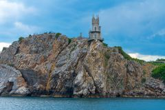 Swallows Nest castle on the rock over the Black Sea, Crimea, Yalta. landmark of Crimea, view from sea.  stock photography