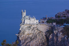 Swallows Nest after sunset. The building in the style of a castle on a cliff top floodlit night Stock Photos