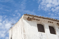 Swallows nest. Swallow's nest under an old Spanish house roof royalty free stock photography