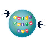 Swallows wrapped around the ground a garland with flags Happy Earth Day Stock Image