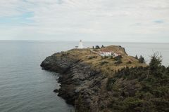 Swallowtail Lightstation. Perched against the vast Atlantic at the mouth of the Bay of Fundy, on Grand Manan Island, New Brunswick, Canada stock photography