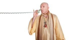 Swami en una llamada de teléfono Imagenes de archivo