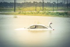 Swamp car flood. Sedan car swamped by flood water in East Houston, Texas, US by Harvey Tropical Storm. Submerged car on deep heavy high water road. Disaster Stock Image